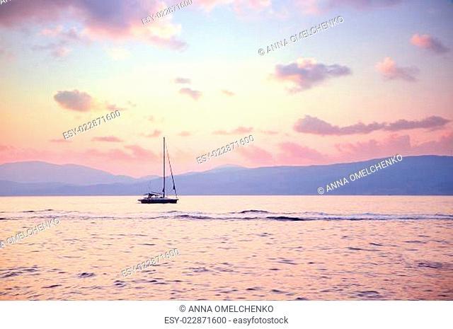 Luxury sailboat in sunset light