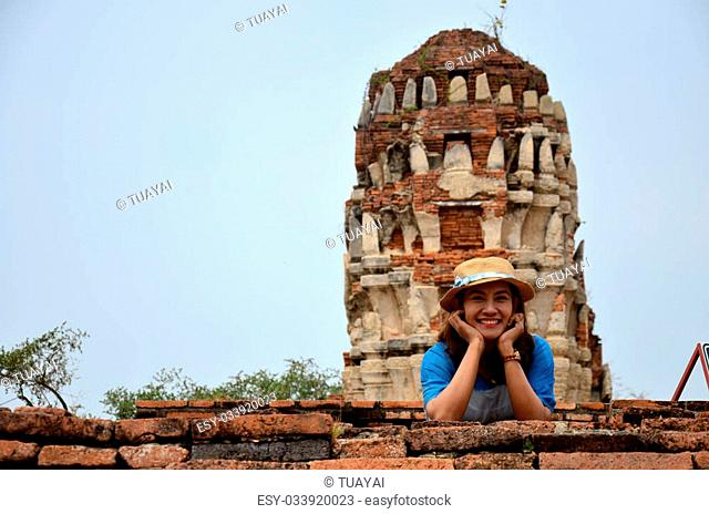 Thai woman portrait at ancient building at Wat Mahathat in Ayutthaya, Thailand