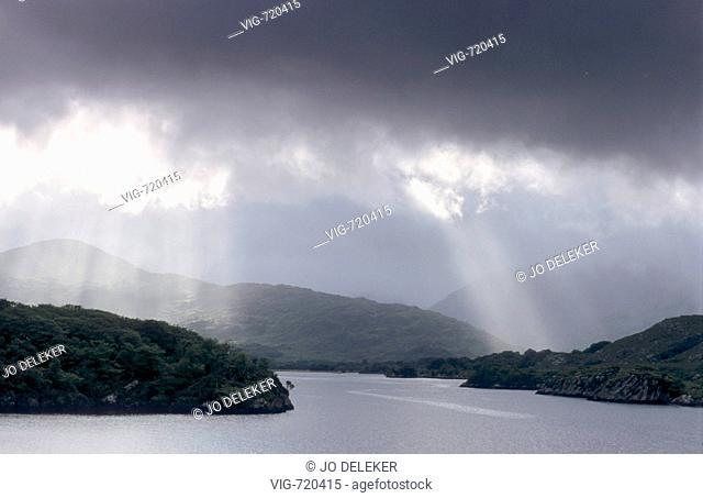 IRELAND, KILLARNEY, 01.08.2007, Dark cloud above Upper Lake near Killarney. - KILLARNEY, IRELAND, 01/08/2007