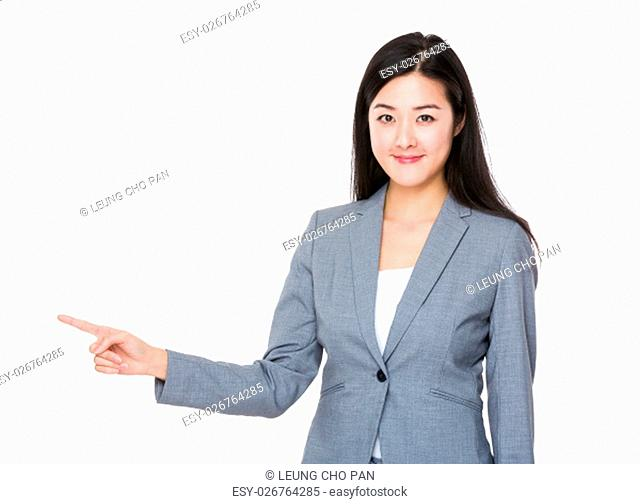 Asian businesswoman finger point to show something