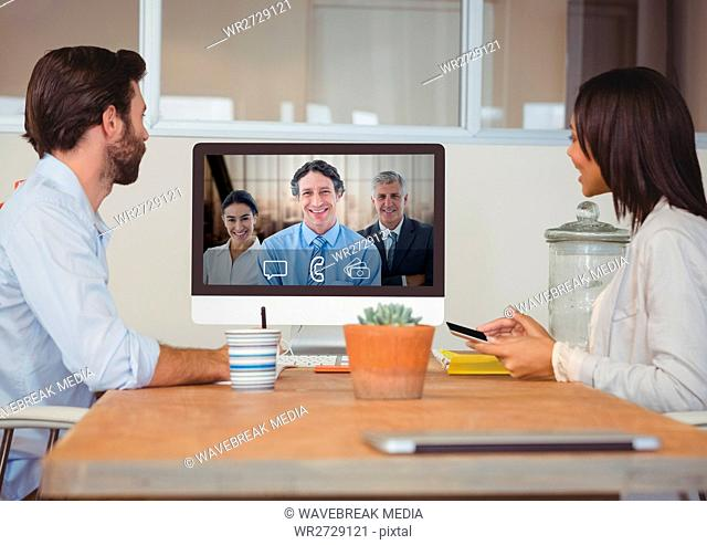 Business people having a video call with colleague on computer