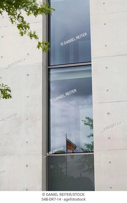 Refelction of German flag on office building, Potsdam, Brandenburg, Germany