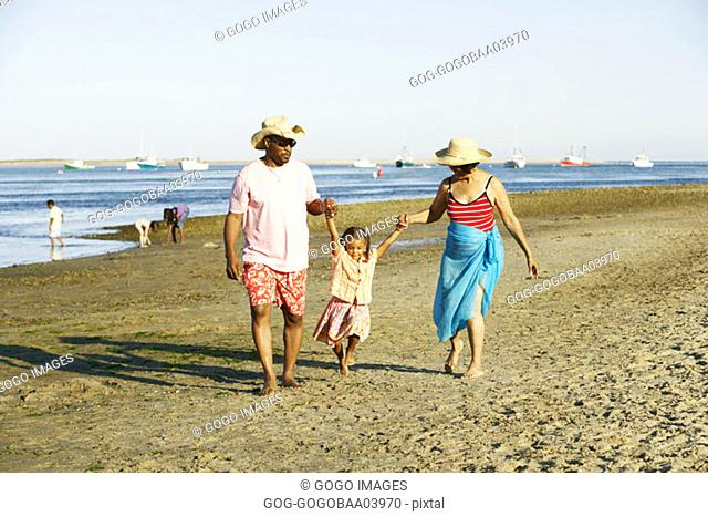 African family walking on the beach hand-in-hand