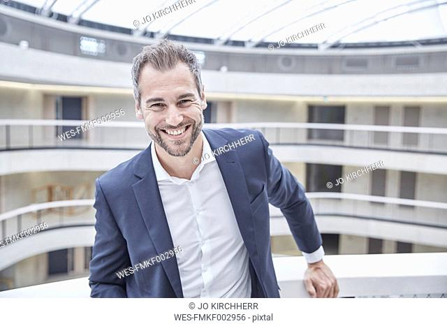 Portrait of smiling businessman in office building