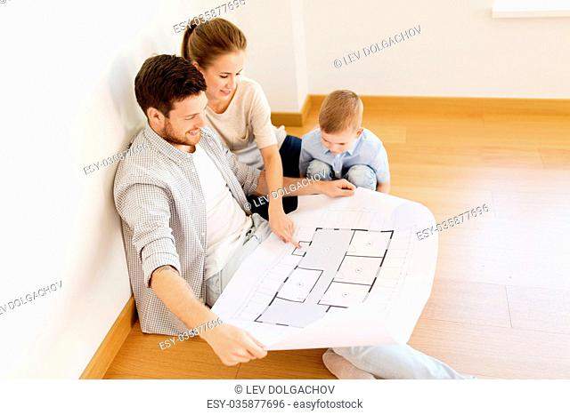 mortgage, people, housing and real estate concept - happy family with blueprint or house project moving to new home