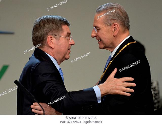 Newly elected IOC President Thomas Bach of Germany (L) embraces outgoing IOC President Jacques Rogge (R) at the 125th IOC Session at the Hilton hotel in Buenos...