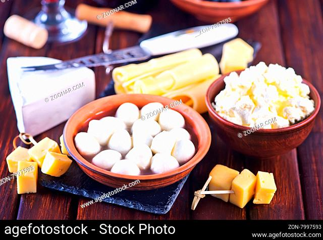 cheese in bowl and on the board