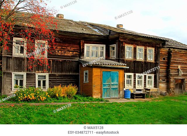 Old fisherman house in North of Russia. Pomors chopped house. White sea
