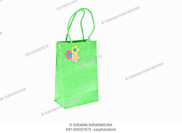 Green mulberry paper bag isolated on white background