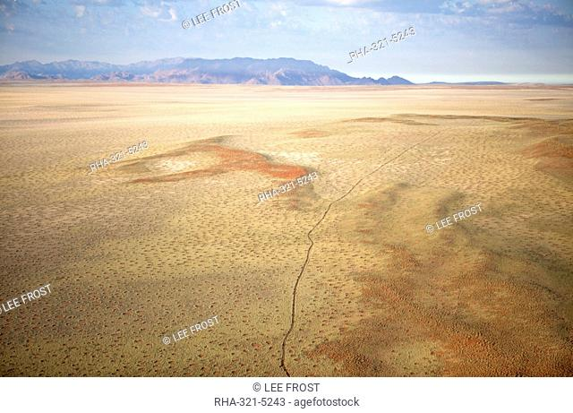 Aerial view from hot air balloon over magnificent desert landscape of sand dunes, mountains and Fairy Circles, Namib Rand game reserve Namib Naukluft Park