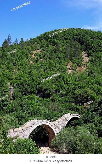 Kalogeriko arched stone bridge landscape Zagoria Greece