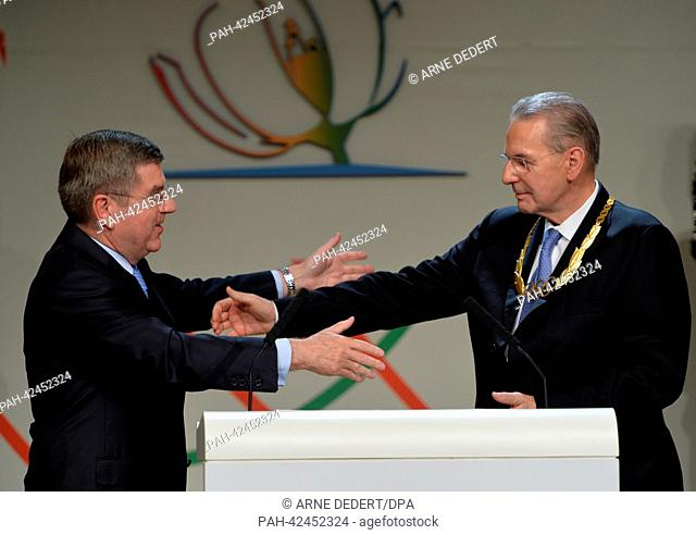 Newle elected IOC President Thomas Bach of Germany (L) embraces outgoing IOC President Jacques Rogge (R) at the 125th IOC Session at the Hilton hotel in Buenos...