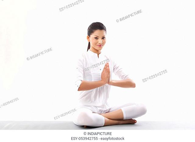 Woman with hands joint doing yoga