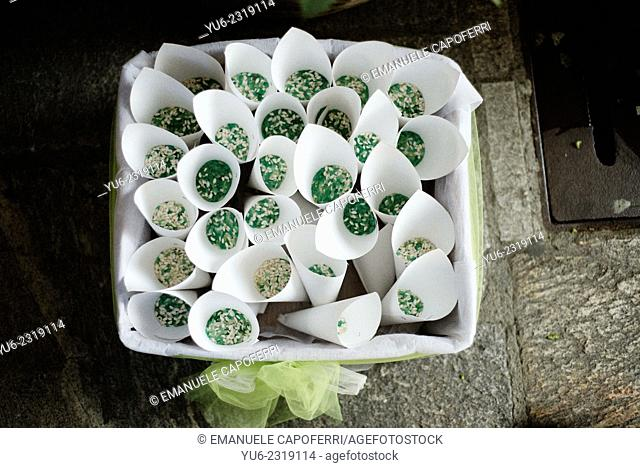 Paper cones filled with rice to be thrown to the newlyweds