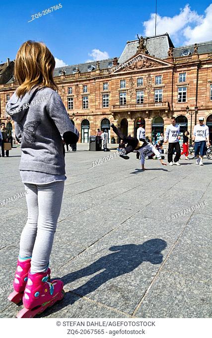 Little Girl watching Breakdancers on the Kleber Square in Strasbourg, Alsace, France