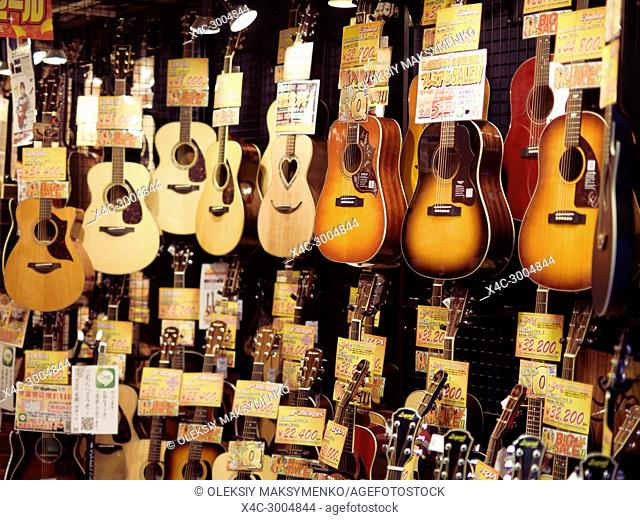Acoustic guitars on display in a music instrument store in Kyoto, Japan