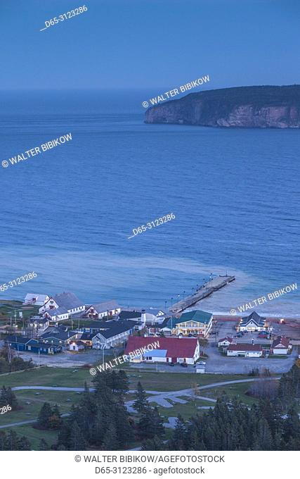 Canada, Quebec, Gaspe Peninsula, Perce, elevated view of town church from Mont Ste-Anne, dusk