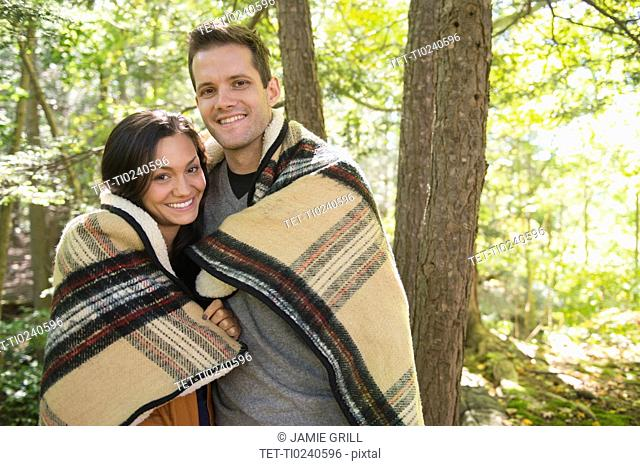 Portrait of couple in forest