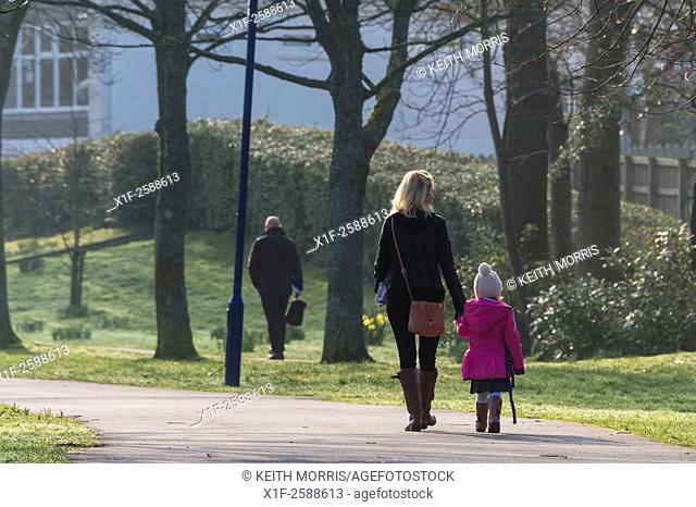 Primary-school age children and their parents walking to school on a cold winter morning, Wales UK