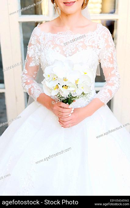 close-up of a bride holding a wedding bouquet. The concept of a wedding festival and a happy life