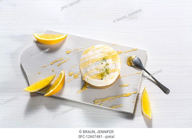Orange tarts with orange sauce and citrus slices