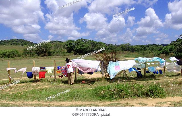 one person hanging out clothes in sergipe