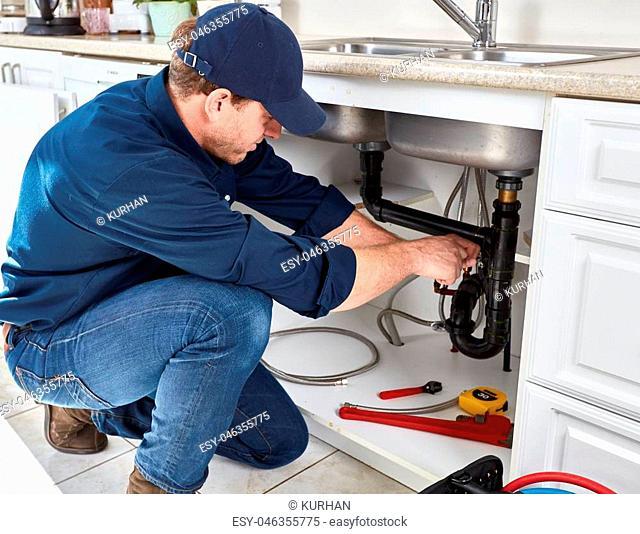Residential plumber doing renovation in kitchen home