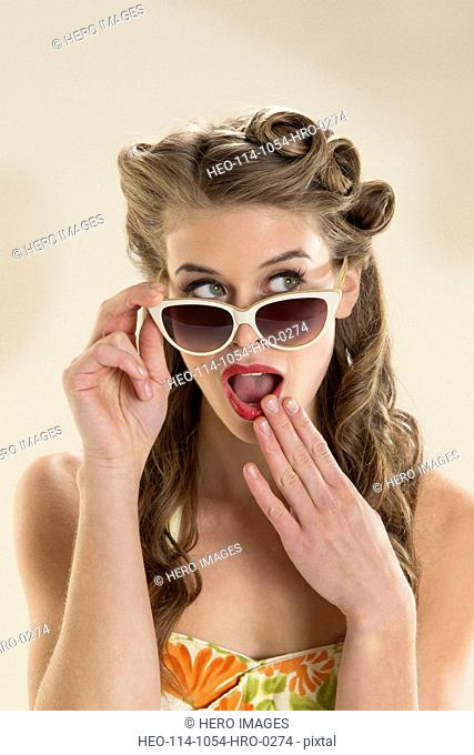 Beach pin-up girl with sunglasses