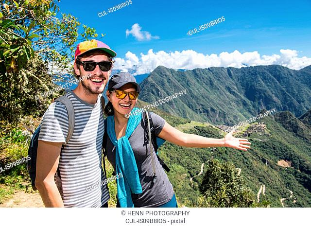 Couple posing for camera on the Inca Trail close to Machu Picchu, Cusco, Peru