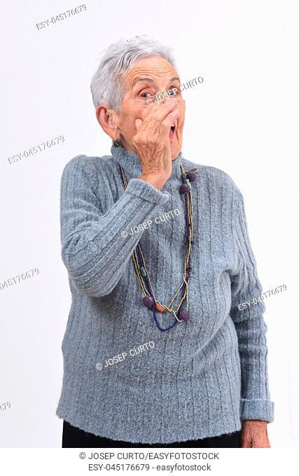 older woman telling a secret