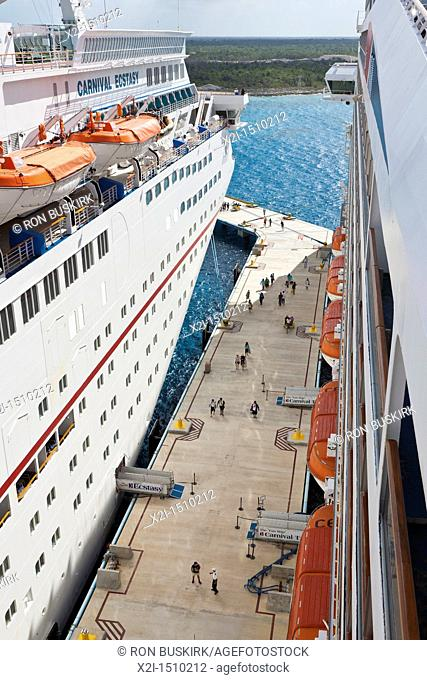 Cruise passengers return to Carnival Ecstasy and Triumph curise ships in port at Cozumel, Mexico in the Caribbean Sea