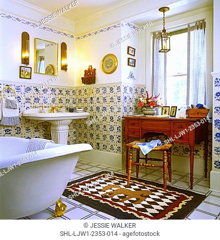 BATHROOMS: Historic bathroom. Blue and white Dutch tiles. White textured pedestal sink on the left in background. Blue, red, and cream rug with a horse pattern