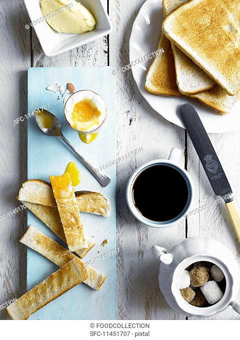 Breakfast with toast and a soft boiled egg