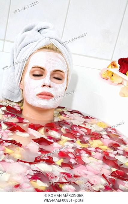 Woman taking a blossom bath, portrait