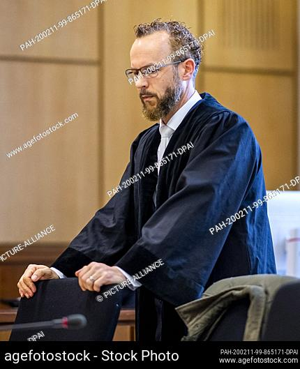 11 February 2020, North Rhine-Westphalia, Hagen: Prosecutor Michael Burggräf is waiting for the beginning of the trial. The defendant is alleged to have stabbed...