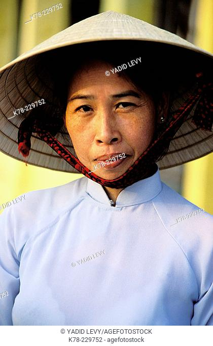 Woman with traditional straw hat. Hoi An. Vietnam