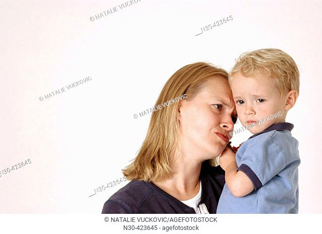 Mother looking sadly at son