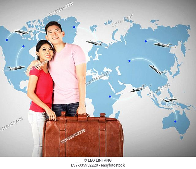 Young couple planning to travel around the world. Travel conceptual image