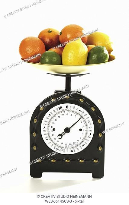 Citrus fruits on scales, close-up