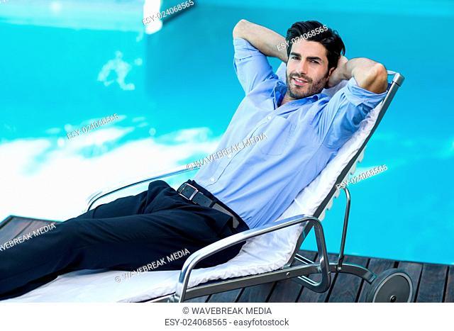 Smart man relaxing on sunlounger