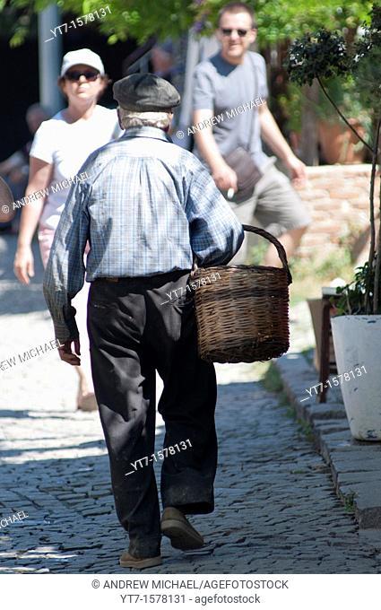 Local man amongst tourists at the old Greek Village of Sirince, Selcuk, Turkey