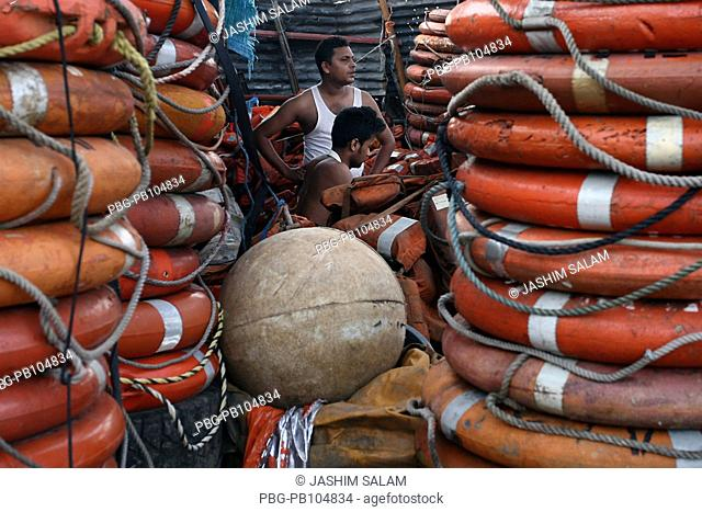 On the way to the ship-breaking yards, at Chittagong Dhaka Trunk Road where countless shops and crafts enterprises are lined up which work off and sell what was...
