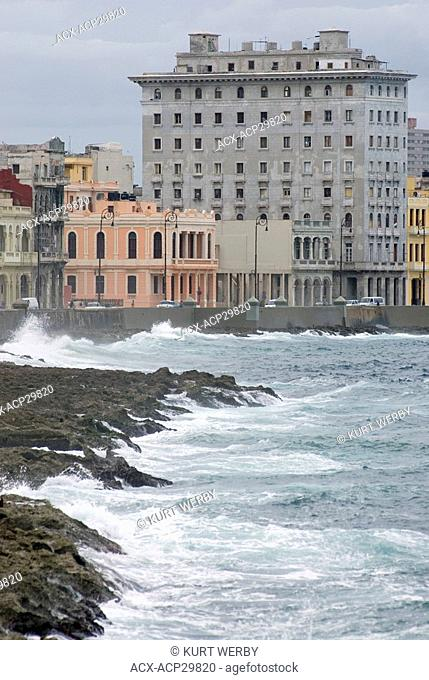 Waves crash along the walls of the Malecon in Havana Cuba