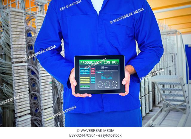 Composite image of smiling male mechanic showing digital tablet
