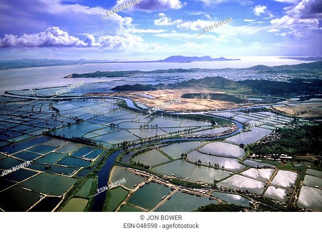 Deep Bay or Hau Hoi Wan, Hong Kong  Aeriel view over landscape now known as Shenzhen Bay, on the northwest coast of Lau Fau Shan, Yuen Long