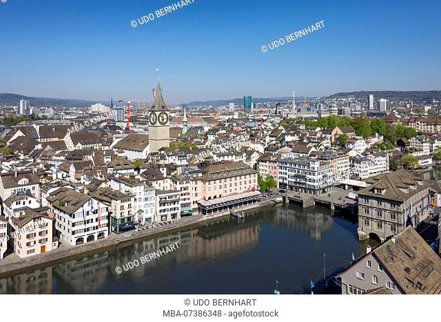 View from Grossmünster on Limmat with Gemüsebrücke and the city with St. Peter's Church, old town, Zurich, Canton of Zurich, Switzerland