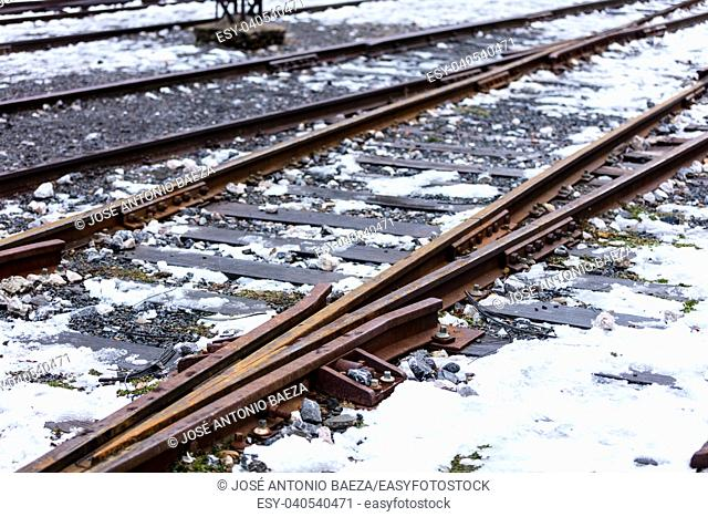 former railways in Canfranc station, Spain, during the first snows of the winter