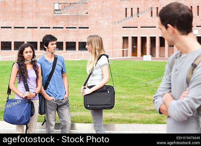 Student looking at one of his classmates talking