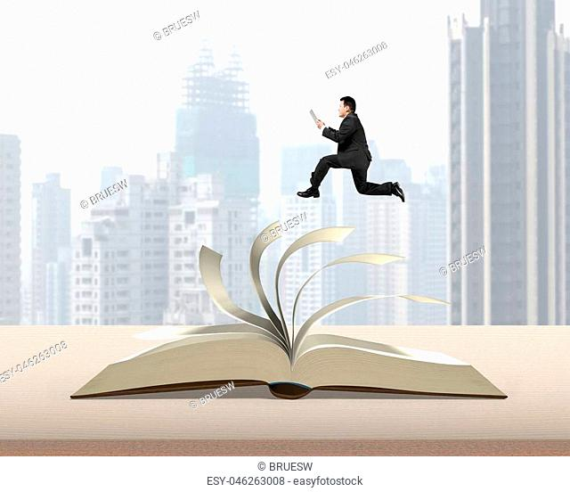 Man holding tablet running on top of flipping pages of open book on table in office with city building view background, 3D rendering