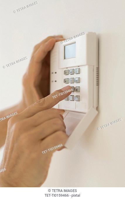 Hand setting code on burglar alarm